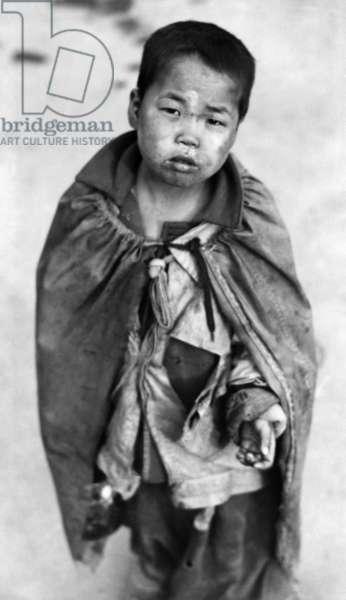 Korean War: A young Korean boy begging for food, Pusan, Korea, 1953.
