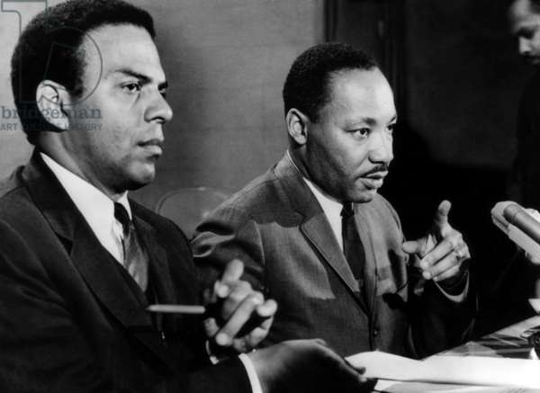 American civil rights activists Andrew Young and Dr. Martin Luther King Jr., at a Southern Christian Leadership Conference in Chicago, Illinois, March 24, 1967.