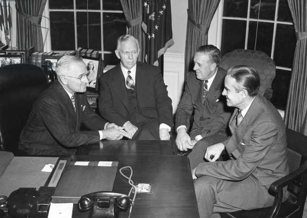 Truman confers with advisors regarding Marshall Plan, Nov. 29, 1948. L-R: Harry Truman, Sec. of State George Marshall, Paul Hoffmann, and Averell Harriman. Paul Hoffmann was director of the Economic Cooperation Administration, which administered the Marsh: Truman confers with advisors regarding Marshall Plan, Nov. 29, 1948. L-R: Harry Truman, Sec. of State George Marshall, Paul Hoffmann, and Averell Harriman. Paul Hoffmann was director of the Economic Cooperation Administration, which administered the Marshall Plan. - (BSLOC_2014_15_69)