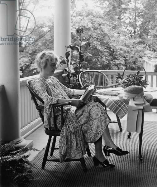Lou Henry Hoover, future First Lady, reading on her porch in 1926. She was highly educated and a skilled linguist