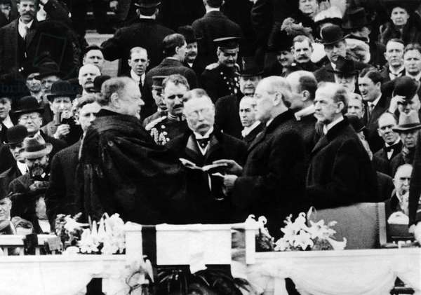 President Elect Woodrow Wilson (center right), taking the oath of office, March 5, 1913