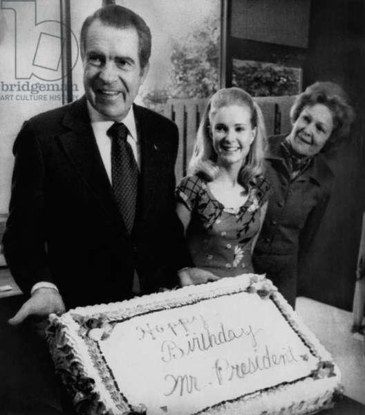 Nixon Presidency. US President Richard Nixon with daughter Tricia Nixon and First Lady Patricia Nixon on Nixon's birthday, Washington, D.C., January 9, 1974