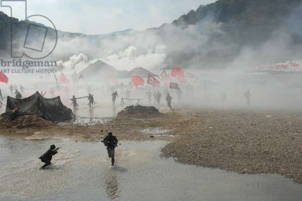 South Korean soldiers dressed as North Korean infantry charge South Korean defenses at the re-enactment of the Nakdong River Battle during the 60th anniversary commemoration of the Korean War in Waegwan South Korea. Sept. 3 2010