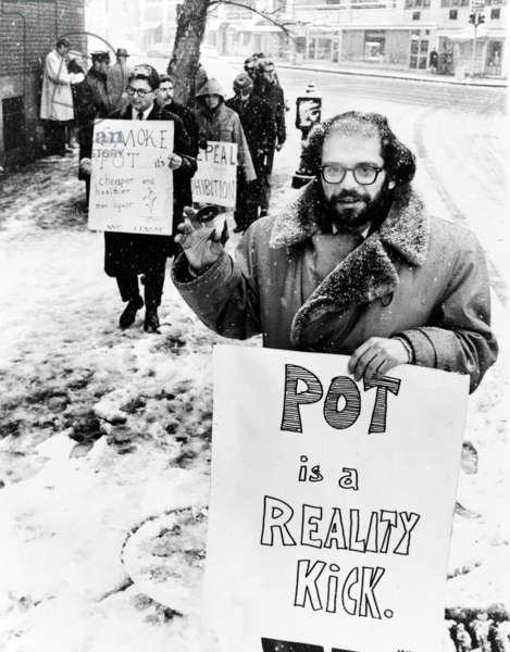 Allen Ginsberg (1927-1997), American Beat poet, leads a group of demonstrators outside the Women's House of Detention in Greenwich Village, demanding the release of prisoners arrested for use or possession of marijuana. 1965