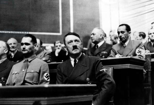 Rudolf Hess and Adolf Hitler during the Reichstag session at which Hitler gave his last warning to the British Empire. Seated behind them are Joseph Goebbels and Count Von Neurath. Berlin, Germany. August 1940