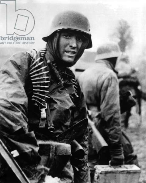 Heavily armed German soldiers advancing in Belgium through thin American lines. Dec. 16-22, 1944. Still from a captured German film. Battle of the Bulge, World War 2