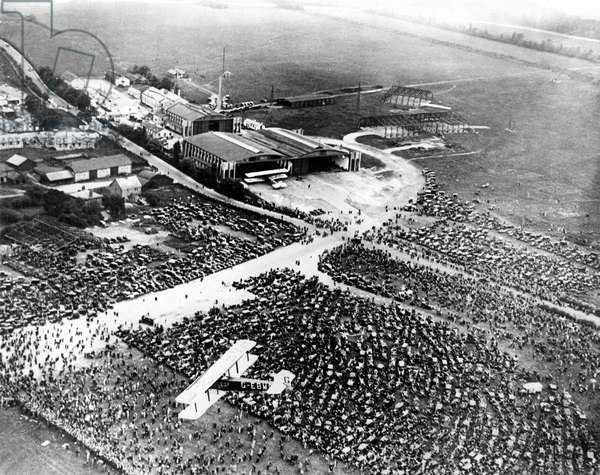 A view from the air of the huge crowds gathered at the Croyden Airdrome to greet Captain Charles A. Lindbergh when he flew the Spirit of St. Louis across the English Channel from Paris to England in 1927