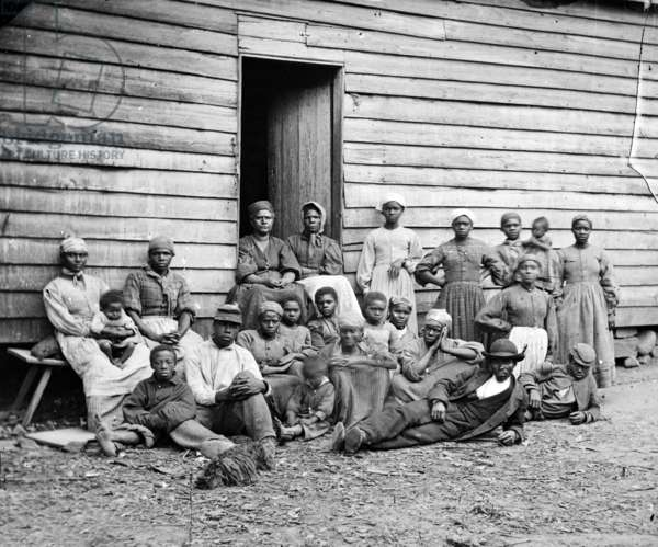 The Civil War, African American 'contrabands' (escaped slaves), at Foller's house, Cumberland Landing, Virginia, by James F. Gibson, 1862