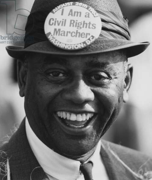 1963 March on Washington. Smiling marcher wearing a hat with a button that reads: 'I am a Civil Rights Marcher.' Aug. 28, 1963