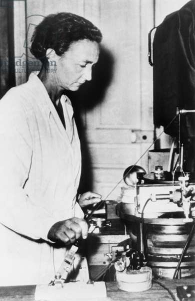 Irene Joliot-Curie, French nuclear physicist and daughter of Marie Curie at work in her lab. c. 1948