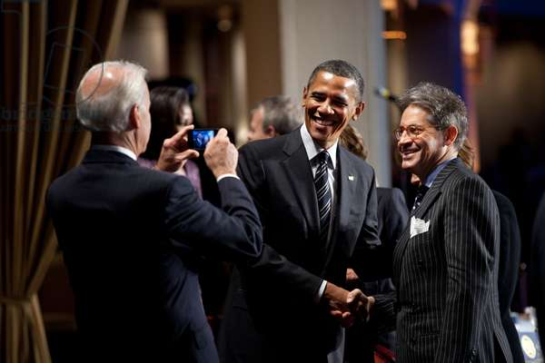 VP Joe Biden snaps a photo of President Obama with author and radio personality Eric Metaxas. Metaxas was the keynote speaker at the National Prayer Breakfast at the Washington Hilton Hotel, Feb. 2, 2012