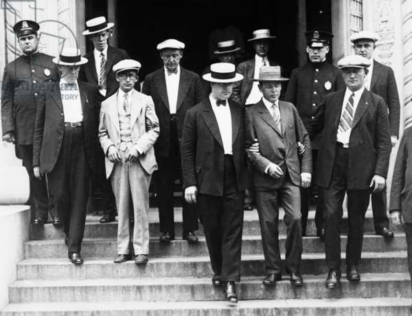 William Seligman (left) and Jacob Miller (right) were arrested by the police of Boston, Mass. A dragnet was set out for radical sympathizers who had created disturbance at a protest of the death sentences of Nicola Sacco and Bartolomeo Vanzetti. It was rumored that the two men are suspected of aiding in the bombing of two NYC subway station. Aug. 15, 1927.