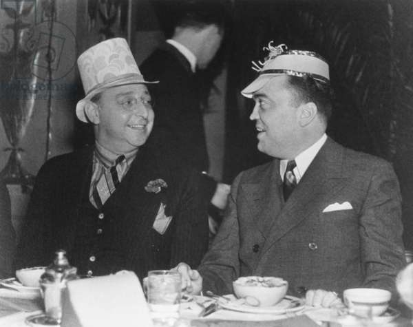 J. Edgar Hoover and Julius Lulley enjoying a festive breakfast at Washington's Mayflower Hotel. c. 1935. Julius Lulley developed the Harvey's Restaurant chain that served passengers of the Santa Fe Railroad.