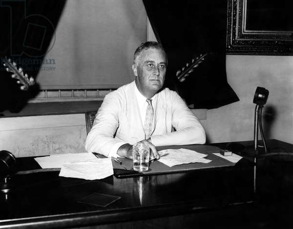 President Franklin D. Roosevelt (1882-1945), in the Oval Office, c.1933