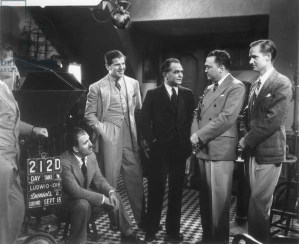 J. Edgar Hoover with Edward G. Robinson and others on MGM Studio's lot set of 'Thunder In the City'. Sept. 28, 1937. On far right is actor Ralph Richardson