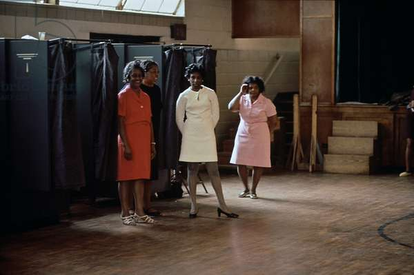 African American women poll workers on an election day in Birmingham Alabama. c. 1975
