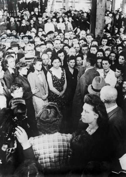German production minister, Albert Speer, addressed workers at a German munitions factory. Speer thanked the men and women for their speedy return to production after the factory was damaged by a bombing raid. 1944. World War 2