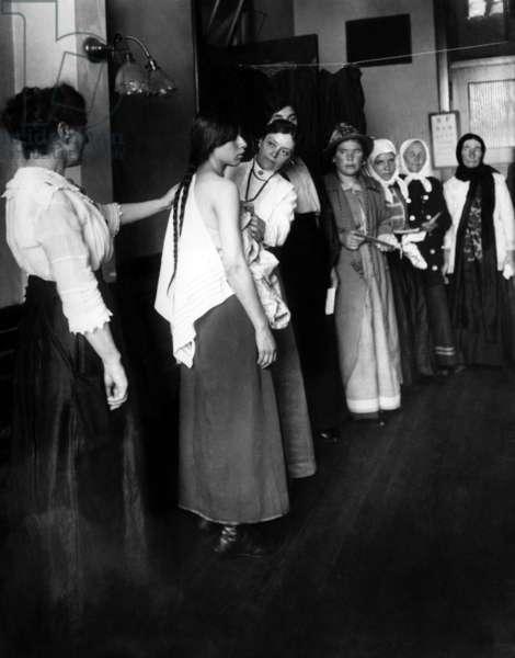 Women immigrants undegoing a physical examination, Ellis Island, New York. c. November 1910