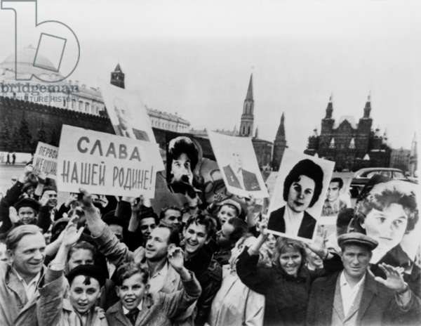 Muscovites cheer twin space triumphs. Russians in Red Square, Moscow, cheering the safe landing of cosmonauts Valentina Tereshkova and Lt. Col. Valery Bykovsky. June 19, 1963