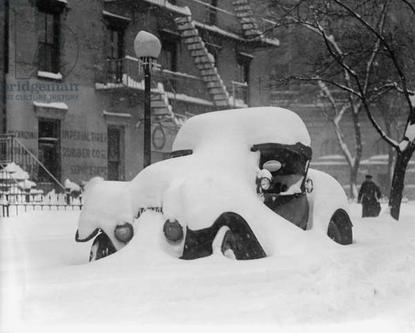 1920's model car is covered with snow after a January 1922 blizzard in Washington, D.C