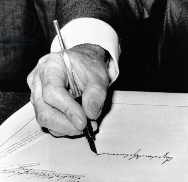 President Lyndon Johnson signing the 1965 Civil Rights Bill, also known as the Voting Rights Act. The law came seven months after Martin Luther King's Selma, Alabama campaign, which pressured Congress to pass the legislation. Aug. 6, 1965