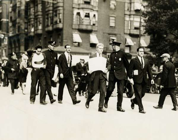 Socialists arrested in Boston, Mass. Harry Canter of N.Y. (left) and Alfred Baker Lewis of Boston, both Socialists, being escorted by the police after being arrested for disturbing the peace. They are sympathizers of Sacco and Vanzetti. c. Aug. 13, 1927.