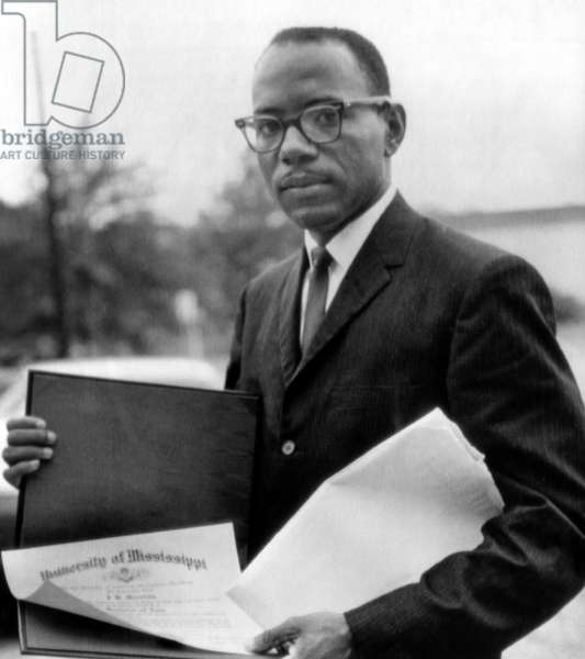 James Meredith, first African American to ever enroll and graduate from the University of Mississippi displays his diploma, Oxford, MS, August 19, 1963.