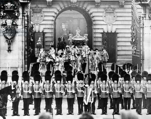 British Royalty. Coronation procession for King George VI of England and British Queen Elizabeth (future Queen Mother), leaving Buckingham Palace, London, England, May 12, 1937