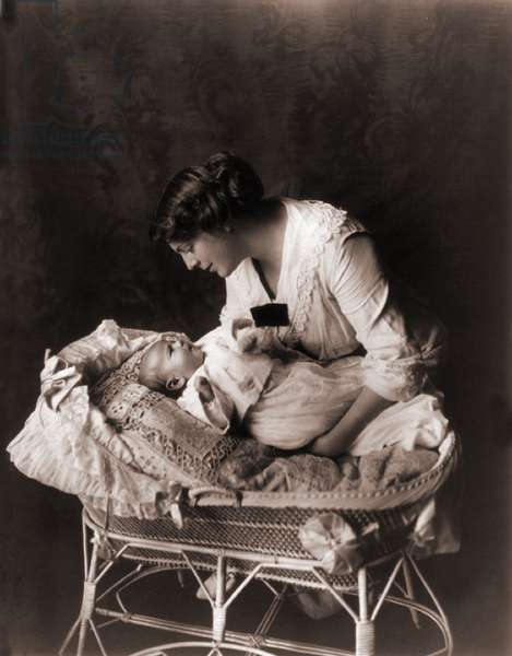 Ethel Barrymore (1879-1959), leaning over the crib of her third child, John Drew Colt (1913–1975) in 1913