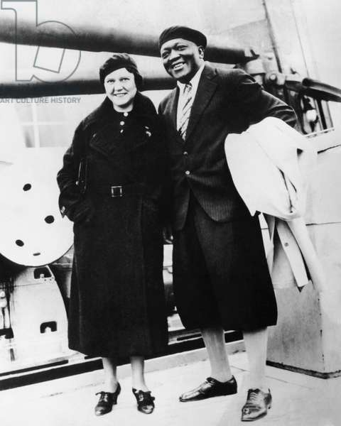 Boxer Jack Johnson, right, and his third wife, Irene Pineau, c. early 1930s