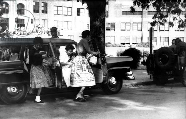 Little Rock, Arkansas: Black students of Central High arrive at school escorted by Federalized National guardsmen, 10/1/57.