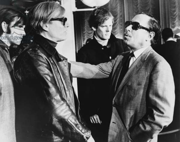 Andy Warhol (left) and Tennessee Williams (right) talking on the S.S. France, 1967