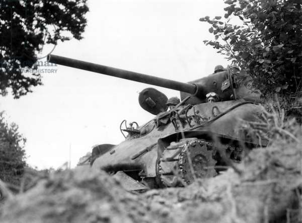 U.S. tank near Mortain, France, the objective of the faltering German counter attack in Normandy. U. S. Sherman tank is equipped with the 'Rhinoceros' hedgecutter welded on it front, enabling it to plow through the Norman hedgerows. August 7, 1944, in Battle of the Falaise Pocket. France, World War 2