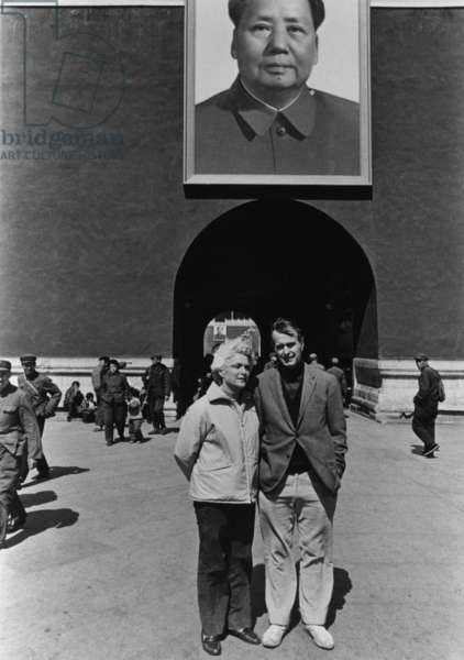 George and Barbara Bush pose beneath a portrait of Mao Zedong in Beijing when he was United States Liaison to China. c. 1974