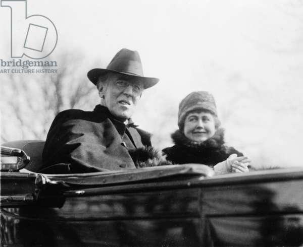 Ex-President Woodrow Wilson (1856-1924) and his second wife, Edith Bolling Galt Wilson riding in an open carriage in Washington, DC in 1923. President Wilson shows the effects of a severe stroke he suffered in October 1919