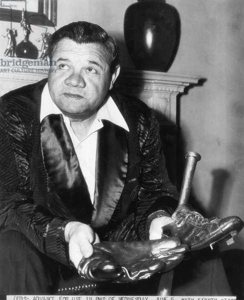 New York Yankees. Retired outfielder Babe Ruth, with bronzed glove, shoes and bat, 1946