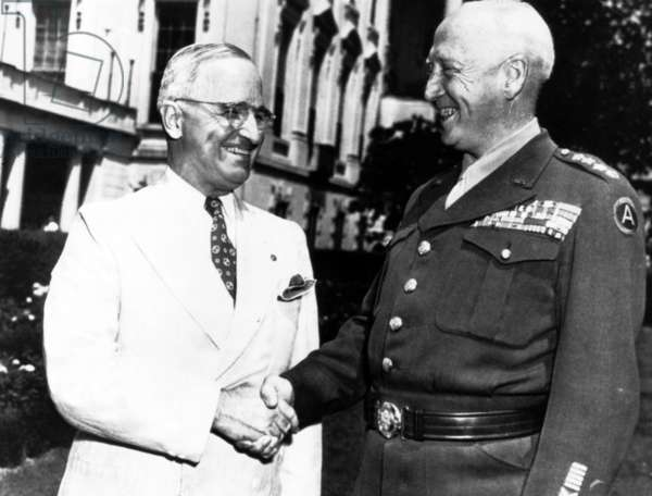 Lt. General George S. Patton shaking hands with President Truman, 1940s