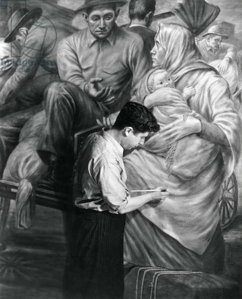Edward Leaning painting a WPA mural at Ellis Island, c. 1937. The mural depicts the role of immigrants to the industrial development of America
