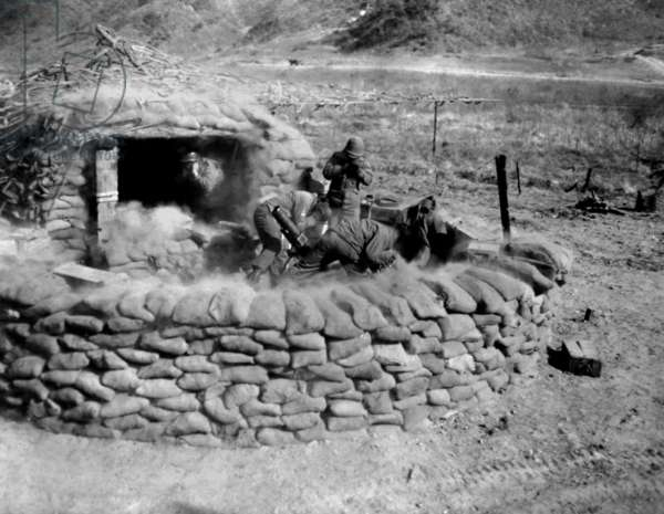 U.S. Soldiers of the 4.2 mortar crew, fire at an enemy position, west of Chorwon, Korea. Feb. 7, 1953. Korean War, 1950-53