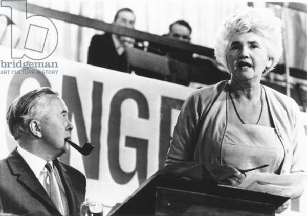 Opening session of the British Labour Party conference, Oct. 3, 1966. Prime Minister Harold Wilson listens to Jenny Lee, widow of famous Laborite Aneuran Bevan