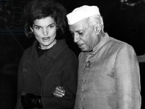 Jacqueline Kennedy, and Indian Prime Minister Jawaharlal Nehru walk towards the White House. November 6, 1961