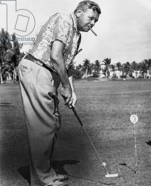 New York Yankees. Retired outfielder Babe Ruth playing golf, c.late 1940s