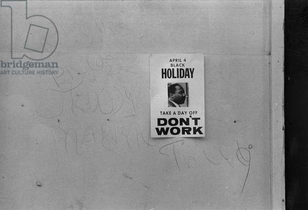 Sign promoting a holiday to honor the anniversary of the assassination of Martin Luther King, Jr., on a shop on H Street, reads: 'Don't work', Washington DC, photograph by Marion S. Trikosko, April 3, 1969