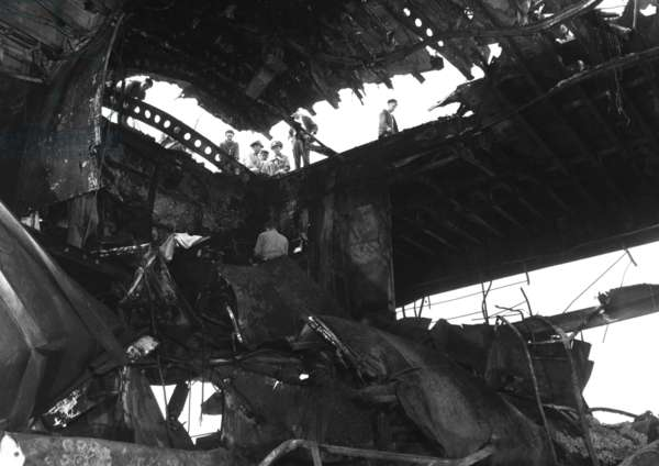 USS Randolph aircraft carrier after a strike by a Japanese Kamikaze suicide plane. The flight deck and hanger were damaged while she was anchored at Ulithi Atoll. March 11, 1945. World War 2