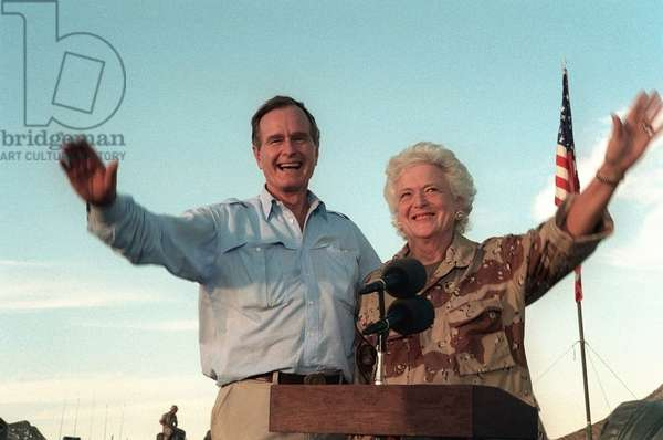 President George Bush and Barbara Bush wave to US troops based in Saudi Arabia preparing for the military operations to oust Iraq invaders from Kuwait. Thanksgiving Day Nov. 20 1990