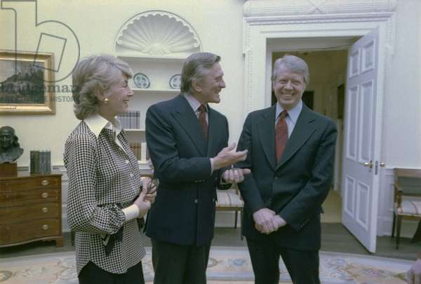President Jimmy Carter greets actor Kirk Douglas and his wife Mrs. Anne Buydens Douglas. March 16 1978