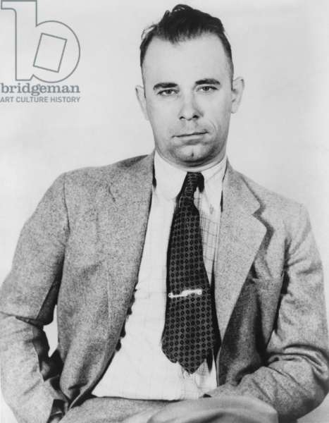 John Dillinger (1903-1934), famous bank robber, in police custody in September 1933, would soon be freed by five former convict pals from the Indiana State Prison. Dillinger has been portrayed by several actors: Lawrence Tierney, 1945; Nick Adams, 1965; Ben Johnson, 1973; Richard Dreyfuss, 1973; and most recently by Johnny Depp, in PUBLIC ENEMIES, 2009