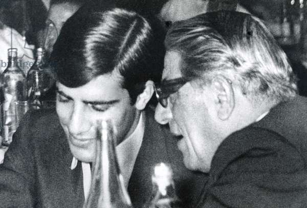 ARISTOTLE ONASSIS (right), with his son ALEXANDER ONASSIS, celebrating his son's 21st Birthday, Athens Greece, c. May 1 1969