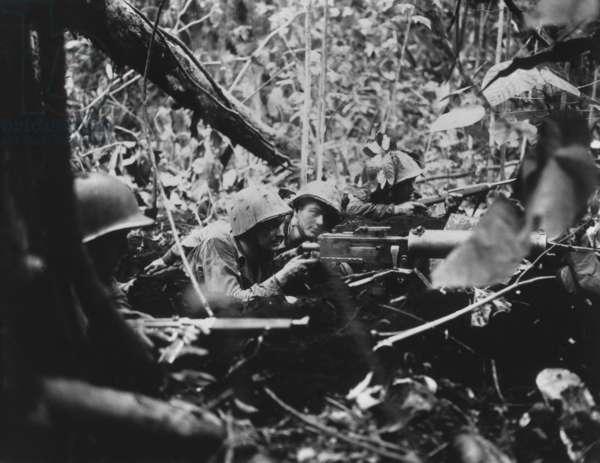 U.S. Marine machine gunners firing at Japanese in Battle of Cape Gloucester, New Britain. Jan. 1, 1944