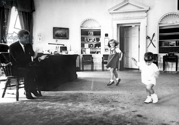John F. Kennedy, in Oval Office with children Caroline Kennedy and son John F. Kennedy Jr., 1962